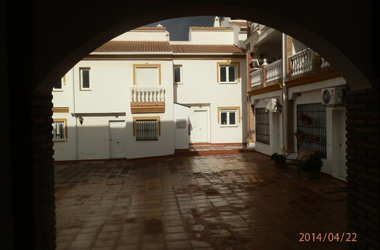 House entrance facing large open Plaza within the urbanización