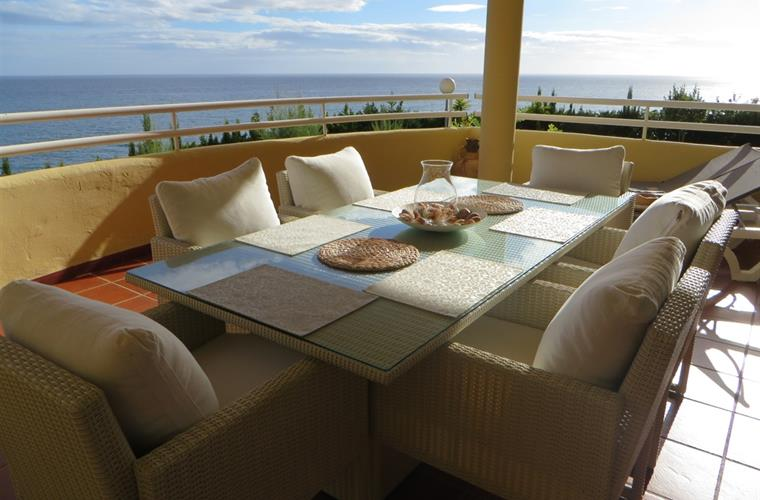 terrace with dining table and sun loungers. AMAZING SEA VIEW!