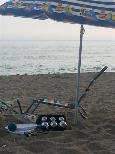 Umbrellas, beach chairs, bocce, badminton