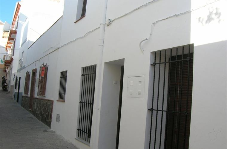 The house on our street. Typical white houses of Andalusia.