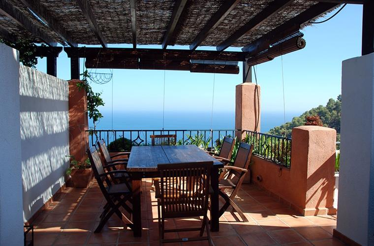 Outdoor covered dining area with beautiful sea views.