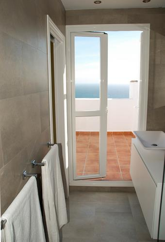 Newly refurbished bathroom with exit to roof top terrace.