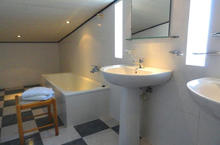 The bathroom on the top, with bathtub