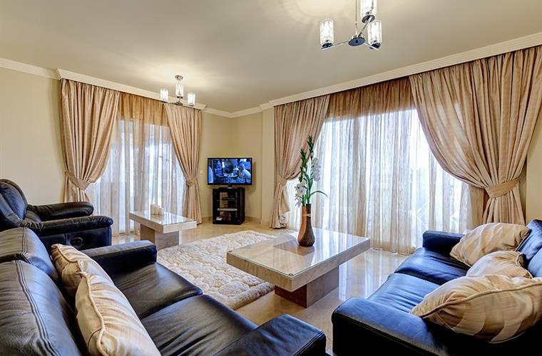 Lounge & TV Area, with voil curtains closed and complete privacy.