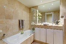 Main en Suite Bathroom with Bath Shower Bidet Loo & 2 washbasins.
