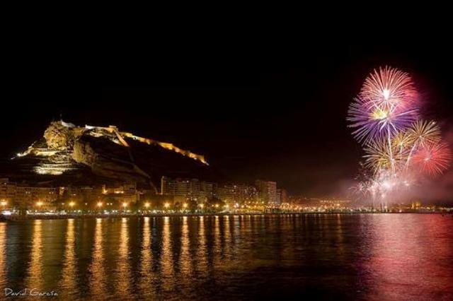 Fireworks at Postiguet beach with Santa Barbara¡s Castle views