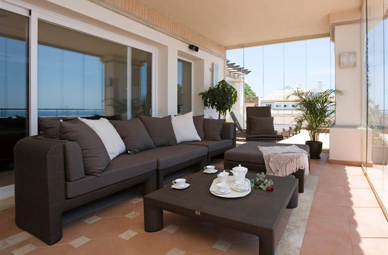 Enjoy the covered seating area on the terrace.  Coffee or siesta?