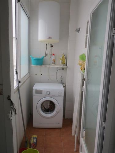 Utility room with washing machine