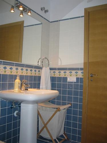 Second bathroom with shower, washbasin and loo.