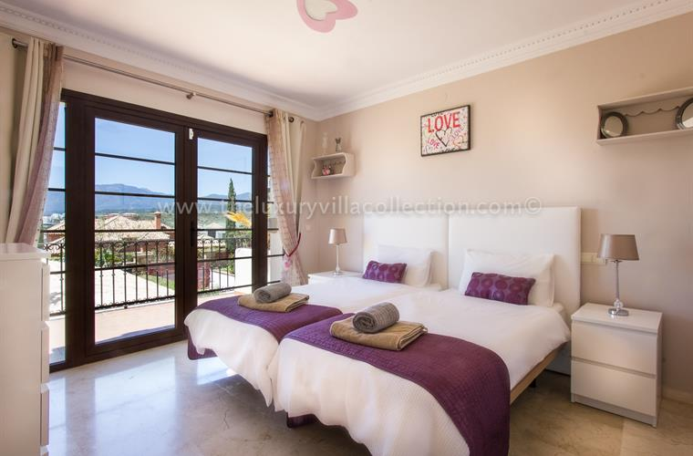Twin bedroom on first floor with mountain and sea views