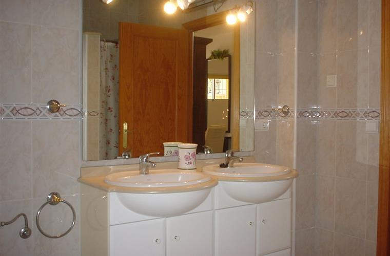 large bathroom with shower and bath