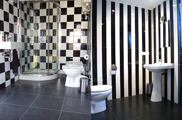 "Our bathrooms are fully tiled with a little ""art deco"" feel."