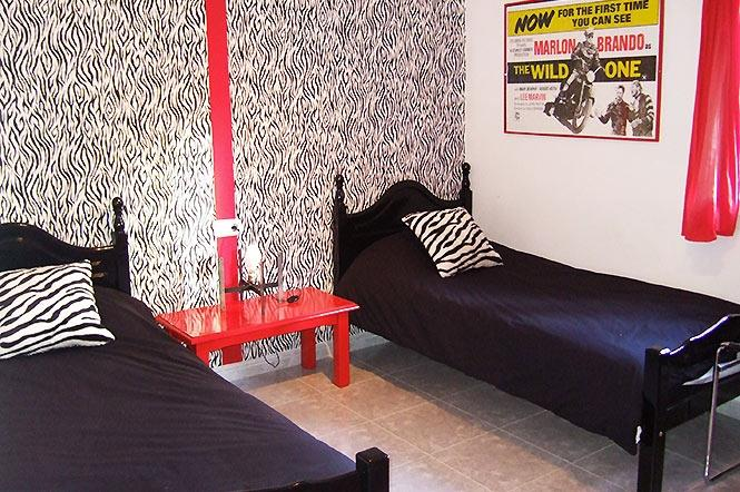 The monochrome twin bedroom in the annex.
