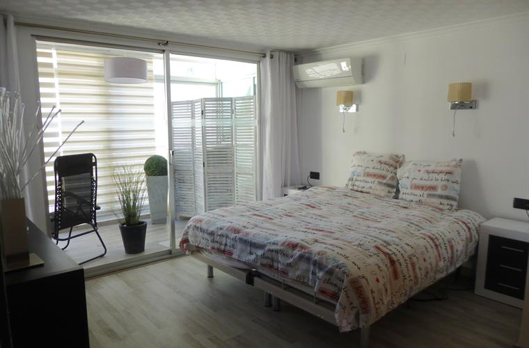 Mater bedroom with balcony with day/night sun curtains