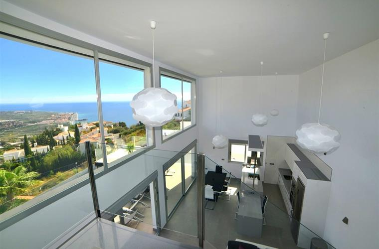 Views from modern open plan living area opens onto pool terrace