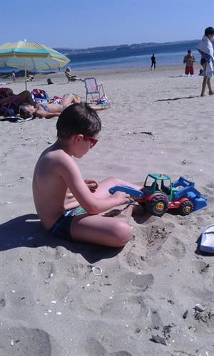 Mini tourist enjoying the sand