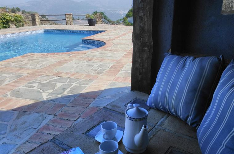 "Coffee in the poolside ""cave"""