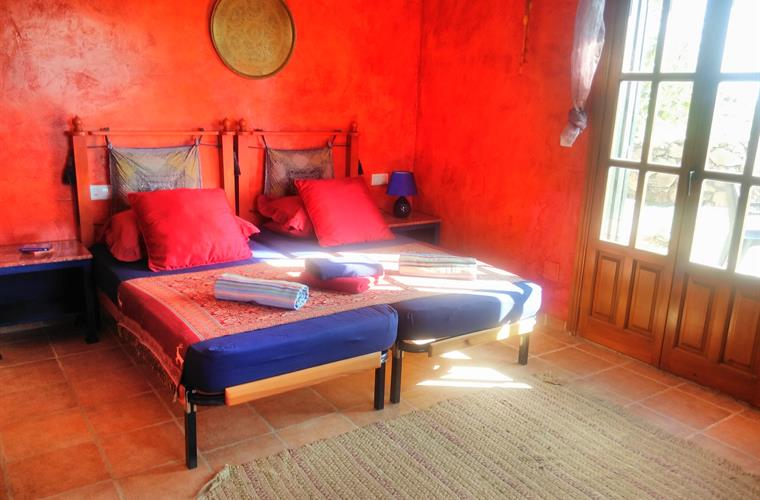 The Moroccan bedroom has twin beds and an en suite shower