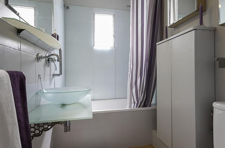 Recently refurbished, spa-like bathroom with bathtub.