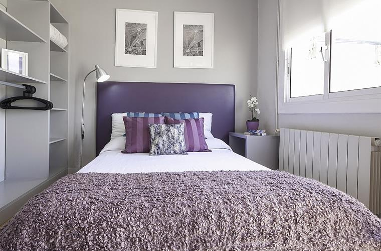 The master bedroom is designed in a beautiful royal purple color.