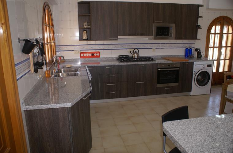 Kitchen with dishwasher, washing machine and microwave