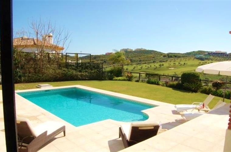 private swimming pool with view over golf course