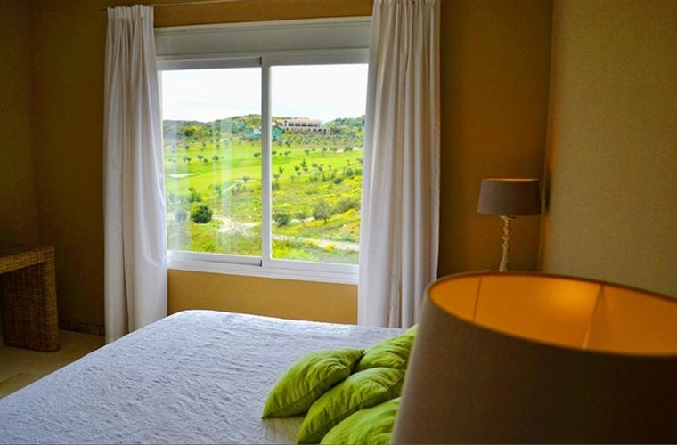 bedroom with view over golf course