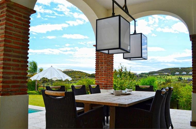 outside dining table with view over golf course