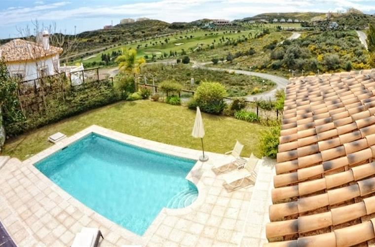 view over swimming pool and golf course