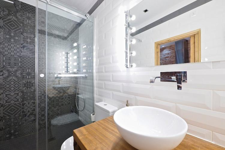 The shower nook with incredible mosaic tiles
