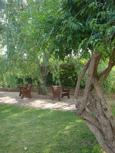 The shaded reading area set in the garden away from the pool