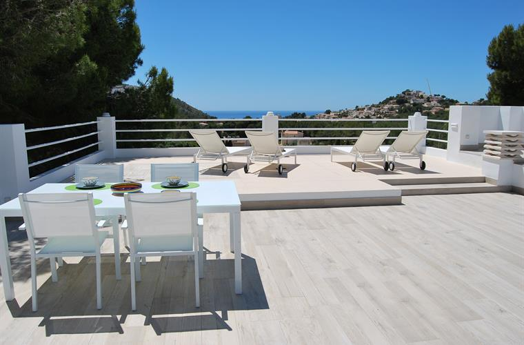 Roof terrace with open mountain and sea views