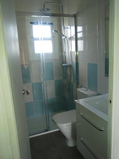 BAthroom with walk-in shower, toilet, sink