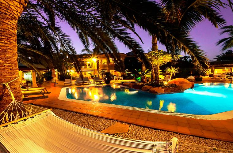 Fairy tale terrace and pool by night.