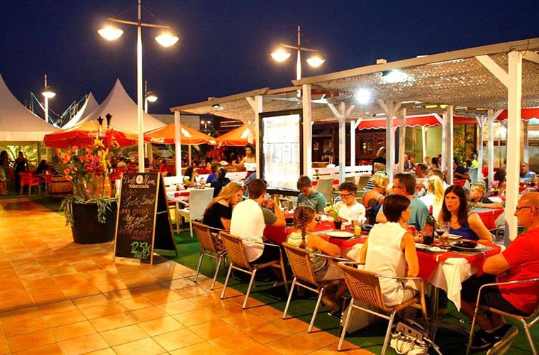 Busy bars and restaurants in the Gran Alacant commercial centre.