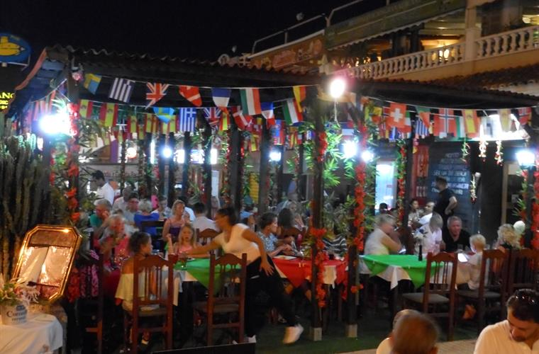 Bars and restaurants at the Carabassi strip, 5 minutes walk