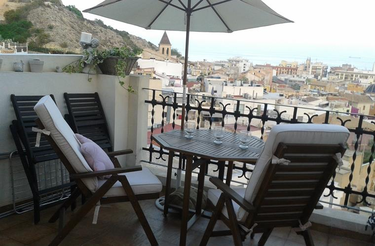 Roof terrace with view of the cold town and the sea