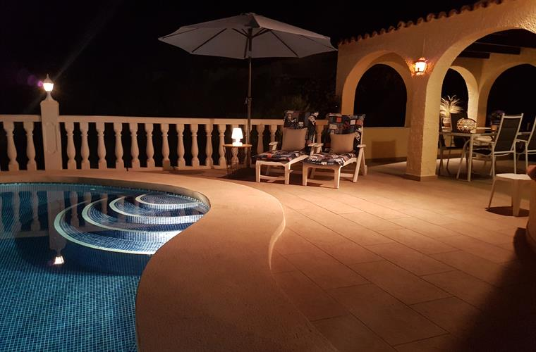 Lovely evening lighting around your pool area