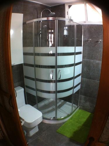 bathroom with toilet on the main level