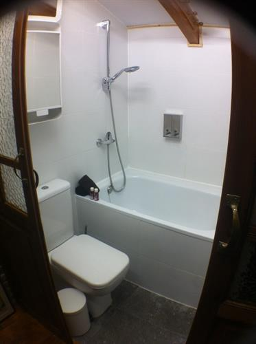 Bathroom with a bath tub and a toilette on the 1st floor