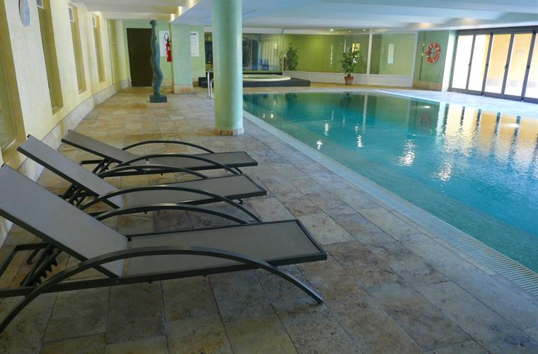 Indoor heated pool with changing rooms and showers
