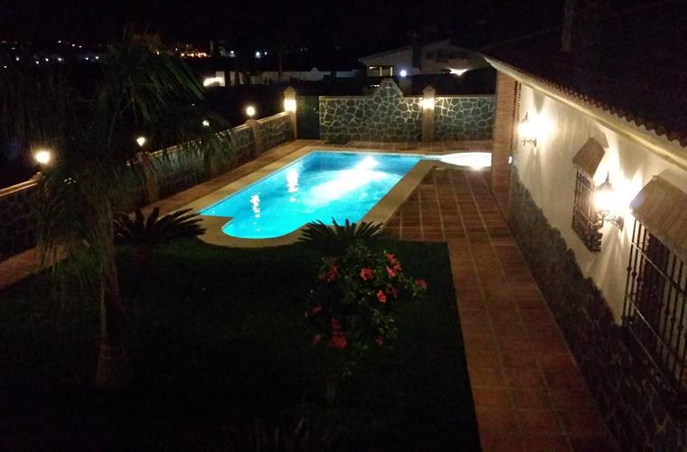 Garden and Pool By Night