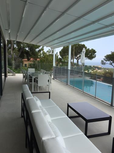 OUTDOOR TERRACE WITH SOFA AND DINING TABLE AND POOL