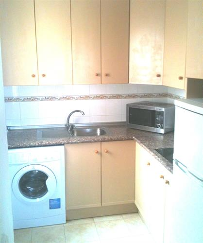 The kitchen has washing machine  fridge freezer, hob, kettle etc