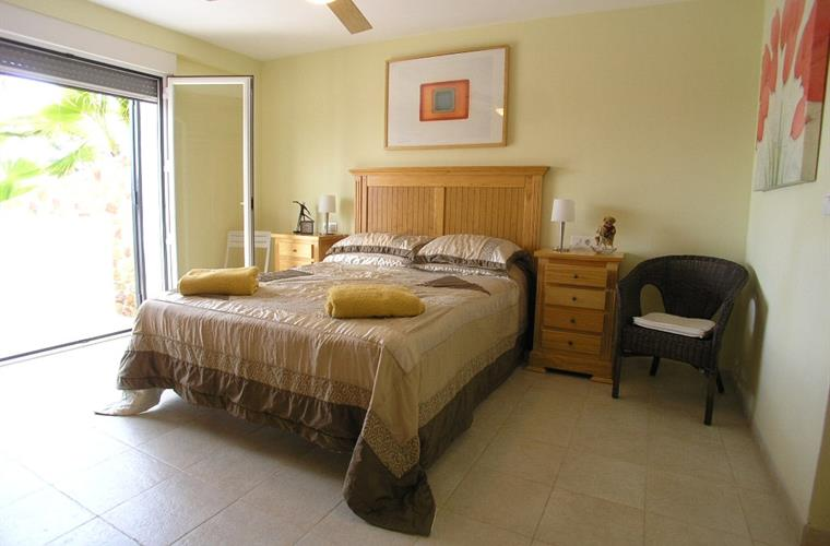 The master bedroom with doors to terrace and sea views