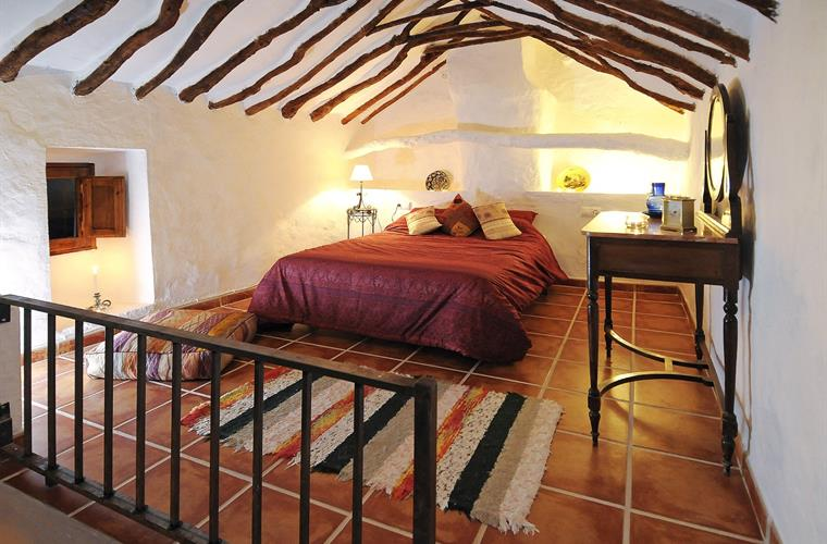 Main bedroom with exposed beams, very typically Andalucian
