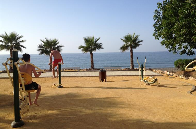 Exercise machines on beach