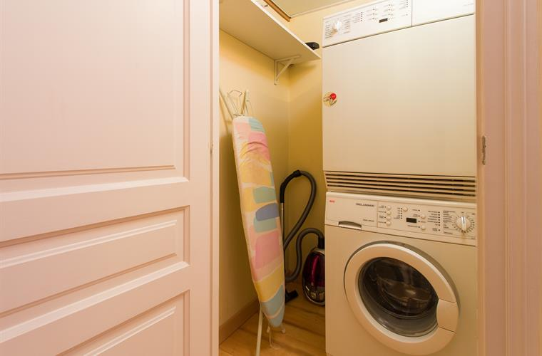 Laundry room with washer, dryer, iron and ironing board