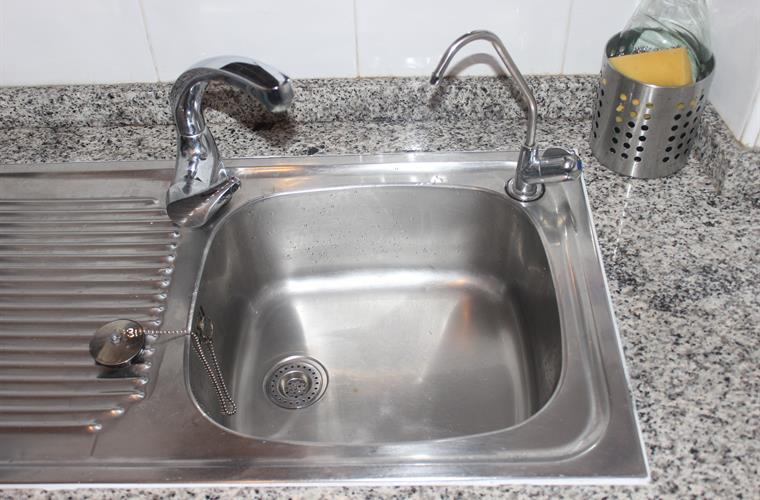 Kitchen sink with water cleaner
