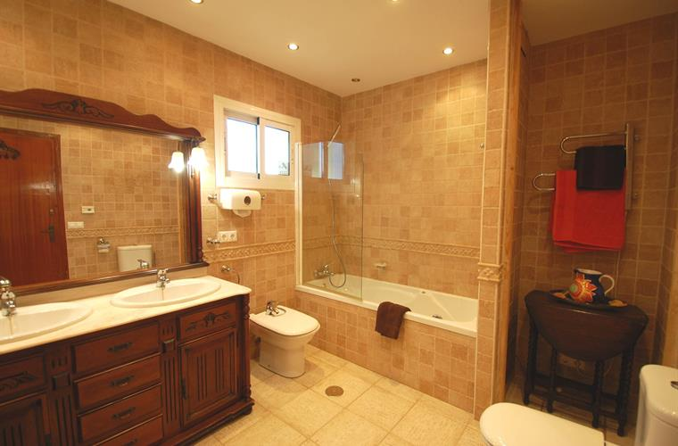 Large ensuite bathroom off main bedroom